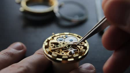 professionalism : Watchmaker is repairing the mechanical watches in his workshop Stock Footage
