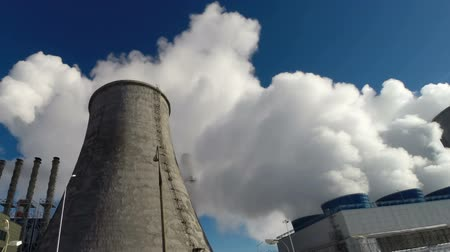 cooling tower : Smoking pipes of power plant on sky background