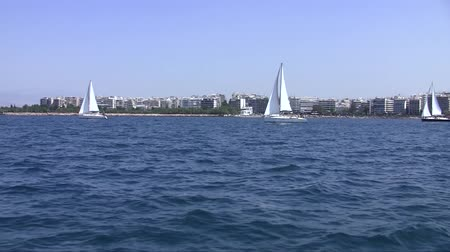 saronic : Sailing boats on a background of Athens