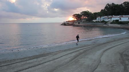 person commits a morning jog along the beach