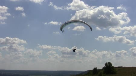 boldness : paraglider flies in the sky over the Cretaceous mountains Stock Footage