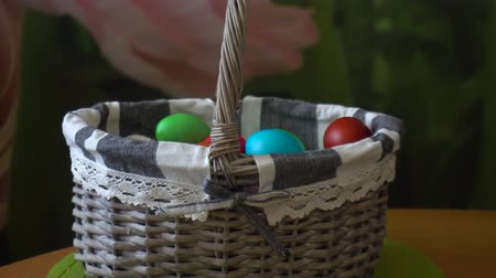 resurrection : Basket with multi-colored Easter eggs Stock Footage