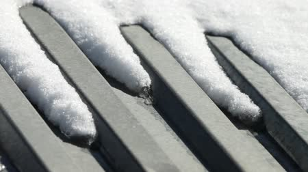 tin roofs : melting snow on the tin roof