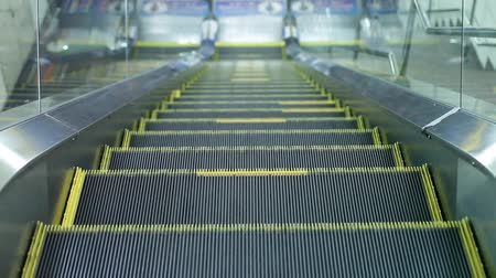 enduring : escalators are shown that constantly run stairs.
