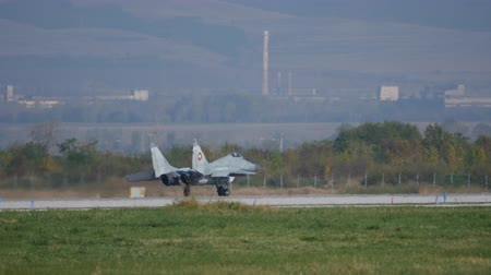 cold war : Cold War era Comunist USSR MiG-29 Airplane of Bulgarian Air Force Run on the Air Base Runway after Landing. Sofia Air ShowBulgaria 11 Oct. 2014 Stock Footage