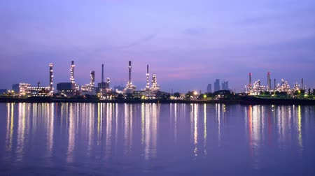 нефтехимический : Time lapse of Oil refinery at the river in sunrise time  Big Factory in sunrise time Стоковые видеозаписи