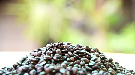 pouring the coffee bean to the heap of coffee bean Stock Footage