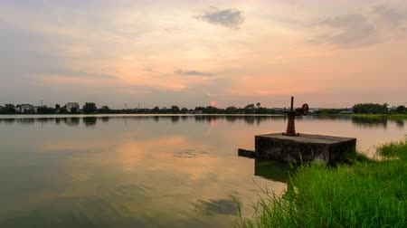 орошение : Day to night time lapse of water gate at canal in sunset time