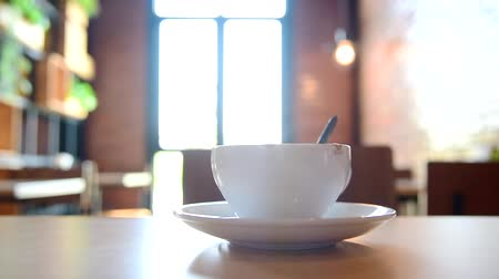 Panning view a cup of coffee on table