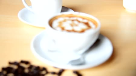 Blur focus to hot coffee on table Stock Footage