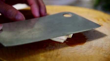pound the lemon grass by cleaver on wood plate  pound the lemon grass for insert to Thai food