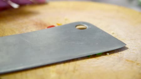 pound the red chilli by cleaver on wood plate  pound the red chilli for insert to Thai food Vídeos