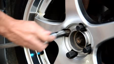 change the wheel of car  Turn the nut for unlock the car  wheel Stock Footage