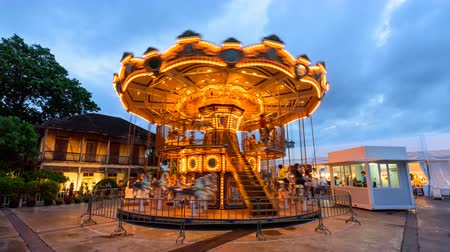 münchen : Bangkok , Thailand -  31  May, 2019 :Day to night time lapse  Carousel in amusement park of  ASIATIQUE The Riverfront shopping center