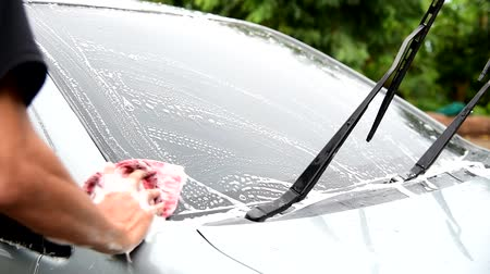 wiper : The man wash the Windshield of car Stock Footage