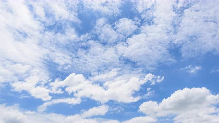 tlen : Time lapse of White cloud disappear in the hot sun on blue sky  White cloud motion loop on blue sky background Wideo