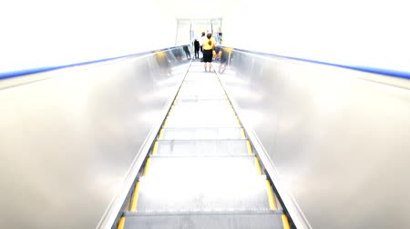 Standing on Outdoor escalator for moving in building Stock Footage