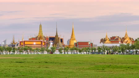 kaew : Bangkok, Thailand -  29 June, 2019 : Day to night time lapse Wat Phra Kaew Public landmark of Thailand in sunset time Stock Footage
