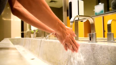 Wash hands by water  protect  your health from disease
