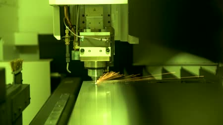 Cnc. Laser cutting of metal. Sparks.