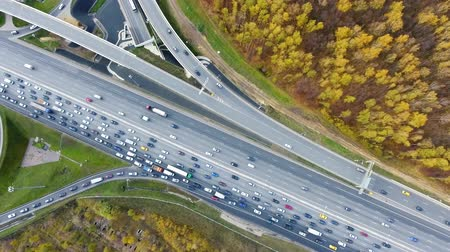 crossing road : Drone flies over the road urban junction. Highway in Moscow. Birds eye view.