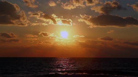 evening sun : Sunset over the sea, HD time lapse clip.
