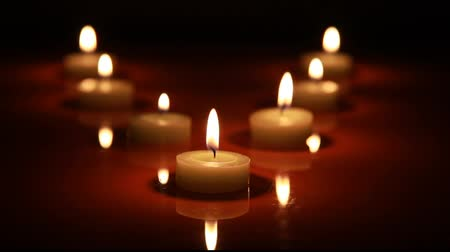 yanmak : Candles in blackness