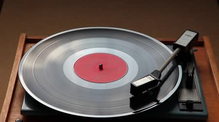 gravar : Close up of a vinyl deck playing a record