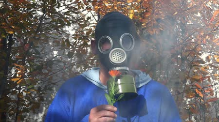 respirator : Smoke rising behind a man in a gas mask Stock Footage