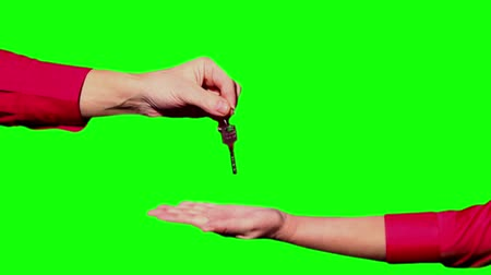 dokument : Handing the keys on a green background.
