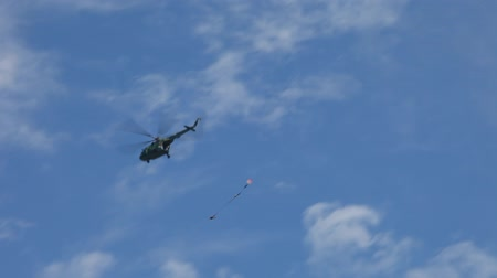 counterterrorism : Military, Helicopter MI - 24 helicopter flight overhead parachute.