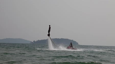 water jet : Man rides a  flyboard in the warm sea
