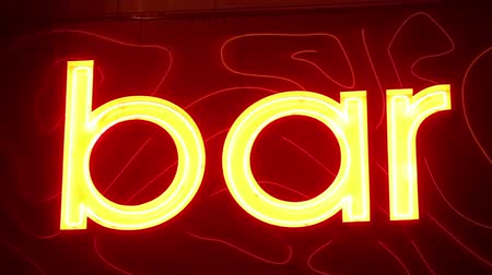 exterior : Bar Sign. Close-up of a neon sign in the bar.