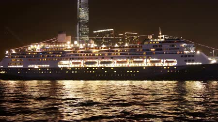 Cruise ship at the pier of Hong Kong in the evening.