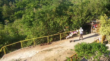 adrenalin : Bohol Island, Philippines- March 25, 2016: Zipline. Staff takes a woman at the end of the route. Dostupné videozáznamy
