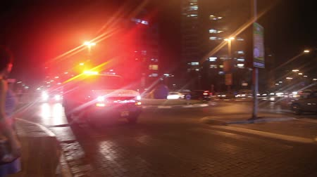ambulância : Tel - Aviv, Israel - June 30, 2016: An ambulance drives down the street with the emergency lights on. With the sound of sirens.