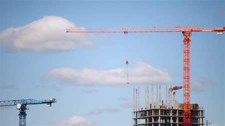 construction crane : Building a house on a background of clouds. Time lapse.