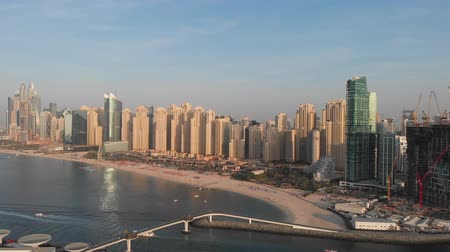 Panorama of Marina Beach in Dubai from the Persian Gulf. United Arab Emirates.
