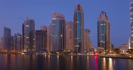 View on Dubai Marina modern towers from night to day. Time Lapse.