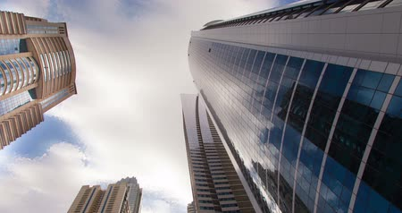 Architectural landscape of commercial building in Dubai Marina. Time Lapse.