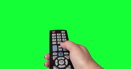 Womans Hand With a TV Remote on green Screen