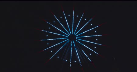 Slow revolving ferris wheel in evening illumination. Stock Footage
