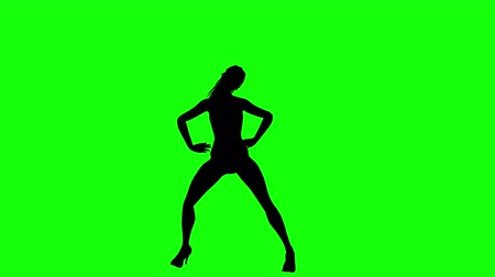 Silhouette Of A Sexy Woman Dancing Isolated On Green Screen
