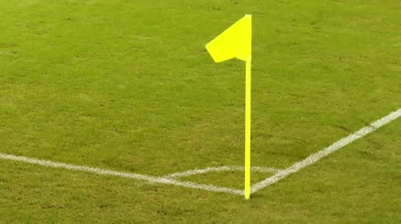 Yellow flag on football pitch corner