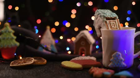 tarçın : Christmas cookies and cup of tea on daark color bokeh lights background Stok Video