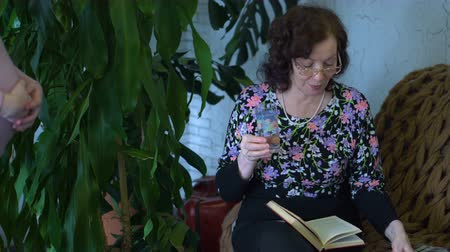 woman at home takes medicine and reads book