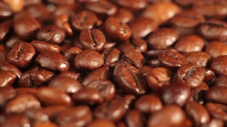 coffe : Roasted coffee beans rotates on the table. closeup Stock Footage