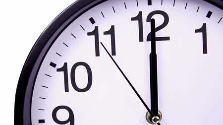 clock hands : Wall clock on a white background 00:00 hours close-up Stock Footage