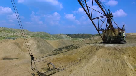 bagger : Flying over the excavator in a quarry. Production of manganese ore. aerial survey