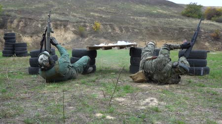 стрельба : Military shooting from automatic weapons AK-74. Teachings on military training ground. Slow motion